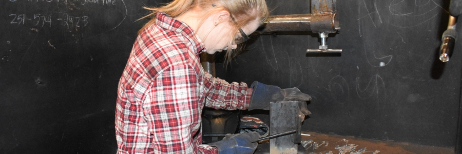 Girl preparing to weld