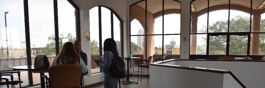 Students talking in atrium
