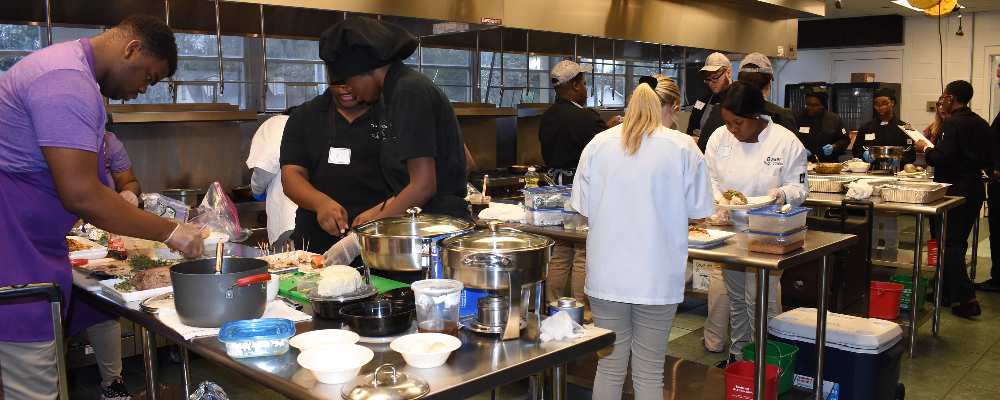 Culinary students cooking in the kitchen