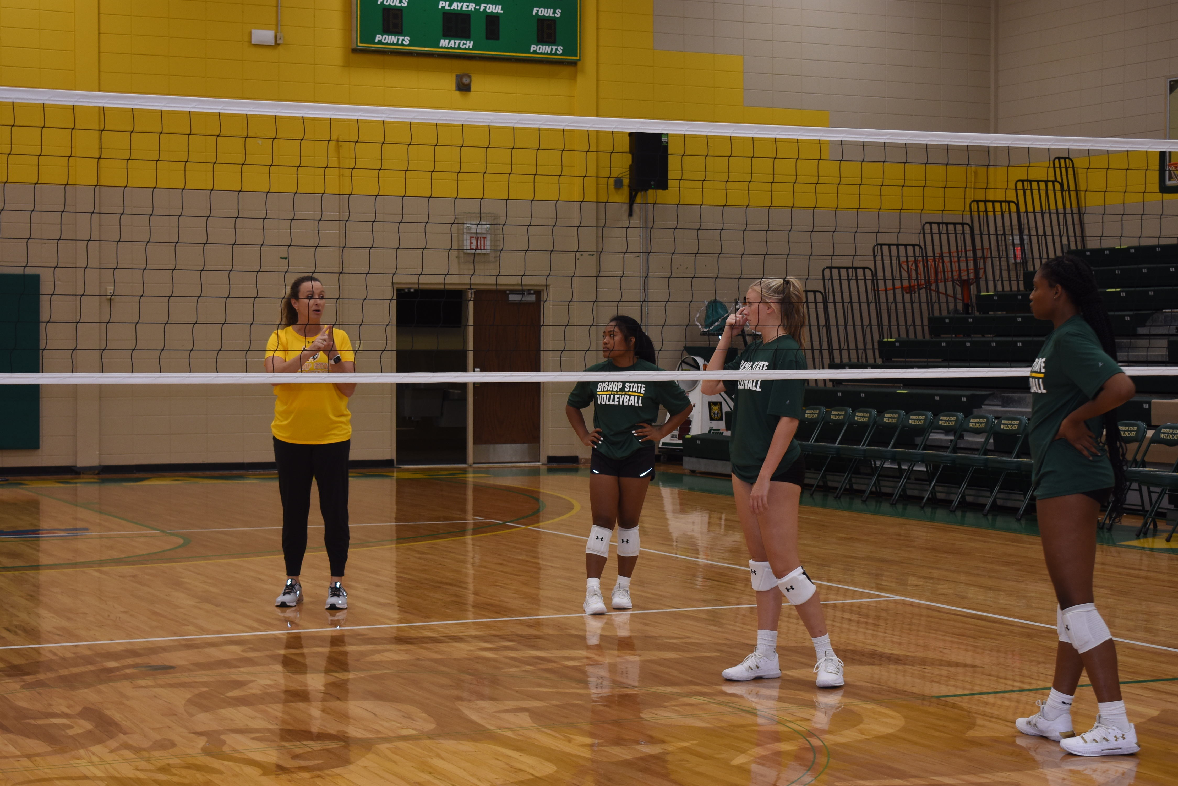 women's volleyball team with coach