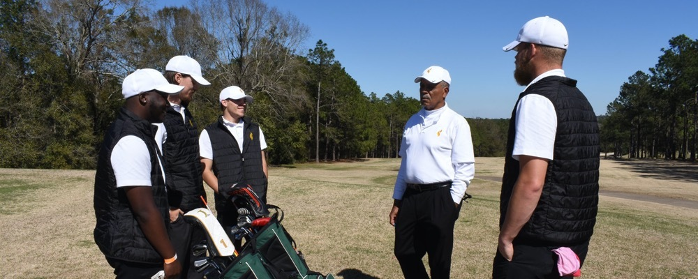 Golf team speaking with each other