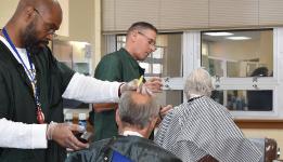 Men having their hair cut in a barber shop