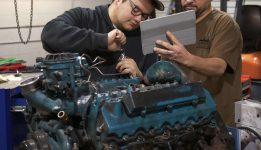 Diesel repair teacher with student