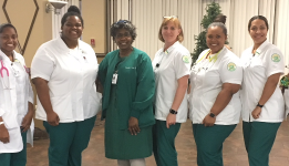 Eight nursing students pose with instructor for a picture