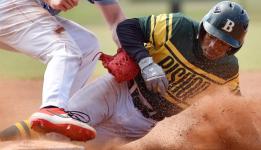 Baseball player sliding to base
