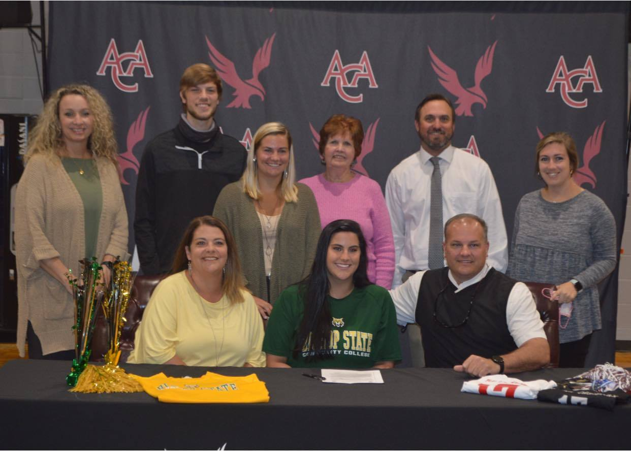 Jordan Smithee with coaches and family