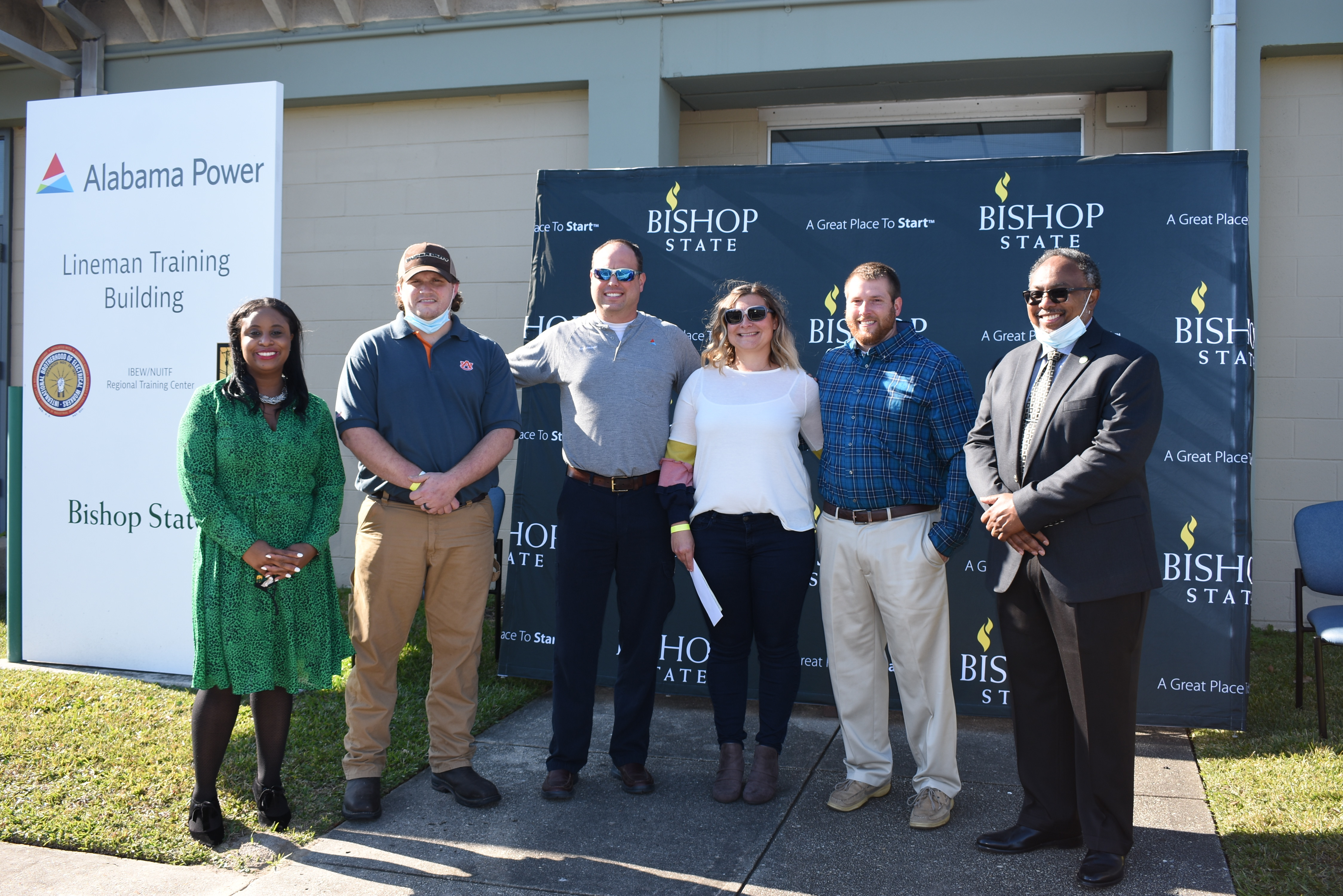 Two veterans enrolled in Bishop State's lineworker training program receive the John Burge Veteran Memorial Scholarship.