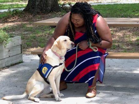 Kearria and her service dog, Darling