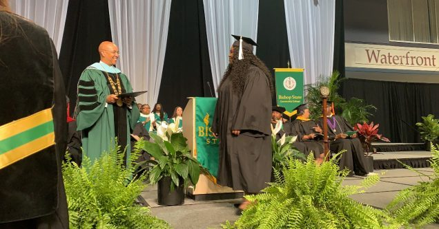Kearria Freed walks the across the stage to receive her associates degree.